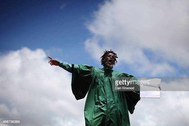 A man preaches during the funeral service of the former South African President Nelson Mandela during his state funeral on December 15 2013 in Qunu...