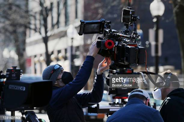 """Man prepares a camera while filming a scene at the on-location movie set for """"The Tender Bar"""" film directed by George Clooney at the South End..."""