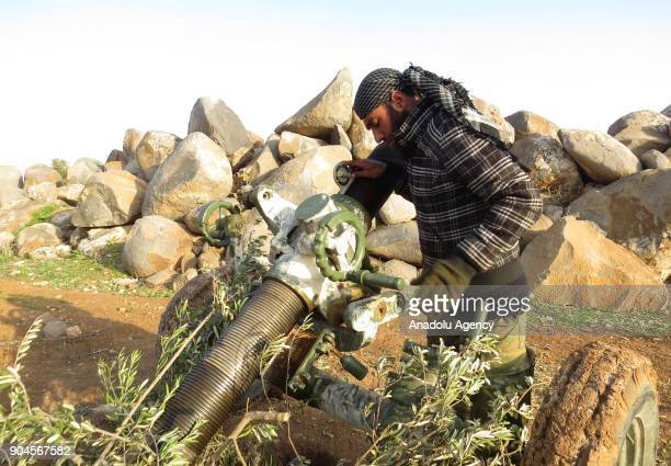 A man prepares a multibarrel rocket launcher within the clashes between armed opposition group Tahrir alSham and Assad Regime forces around the Abu...