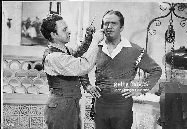 Man prepares actor Douglas Fairbanks before he goes to shoot scenes for the upcoming comedic drama, The Private Life of Don Juan, in which Fairbanks...