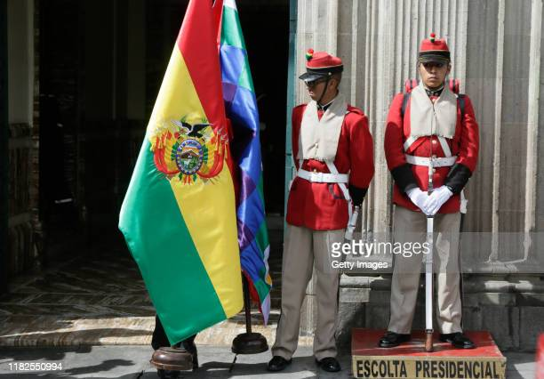 A man prepares bolivian flags next to the presidencial security before a press conference on November 15 2019 in La Paz Bolivia Morales flew to...
