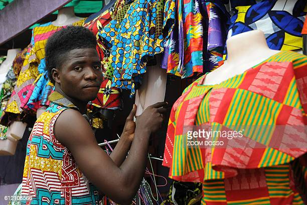 A man prepares clothes to sell at an African clothes shop in Monrovia on September 6 2016 After almost 200 years of Western influence on their...