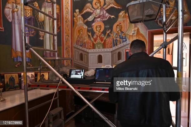 A man prepares computers for live transmittion of mass on the web on April 16 2020 in Athens Greece As part of its COVID19 quarantine measures the...