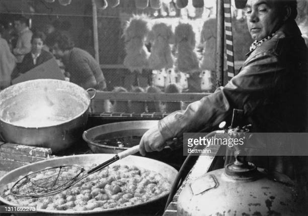 Man prepares food during the Feast of San Gennaro, Mulberry Street in the Little Italy district of the borough of Manhattan in New York City, New...