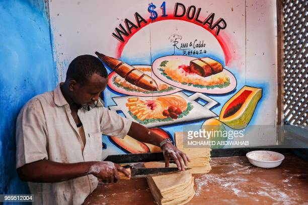 A man prepares food to sell for the Iftar dinner the first meal after the daytime fast during the first day of the month of Ramadan at Hamarweyne...