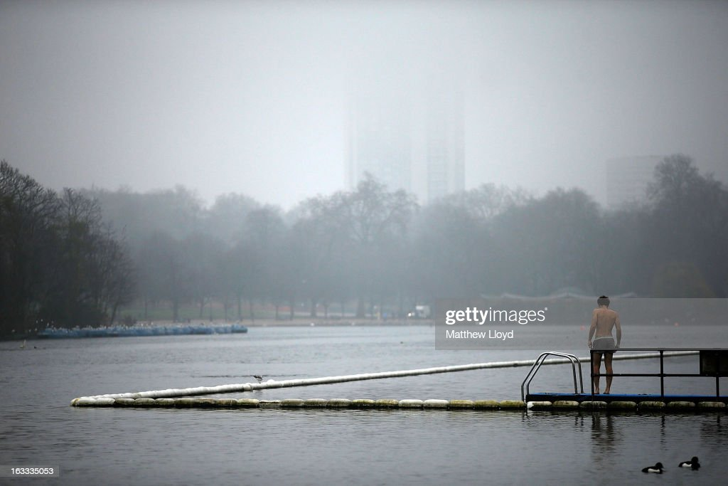 A man prepares for a foggy morning swim in the Serpentine lake in Hyde Park on March 8, 2013 in London, England.