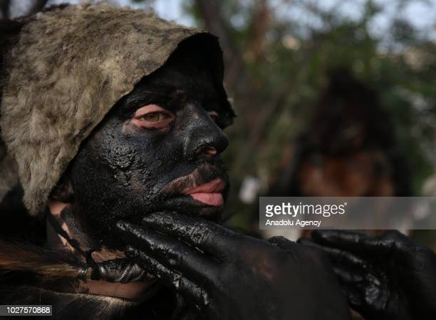 A man prepares for the Hairy Squashes show during the liberation day of Balkesir Turkey on September 06 2018 During the Turkish War of Independence...