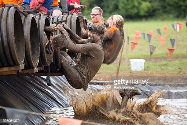 Man prepares himself for a muddy plunge