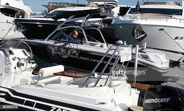 A man prepares his boat for display on the first day of the PSP Southampton Boat Show in Mayflower Park on September 11 2009 in Southampton England...