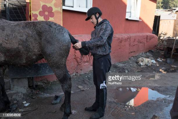 Man prepares his horse in the Fakulteta neighborhood of Sofia, March 16, 2019 during Horse Easter which is celebrated on St. Todor's Day in Bulgaria.