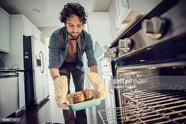 Man prepares meal in kitchen