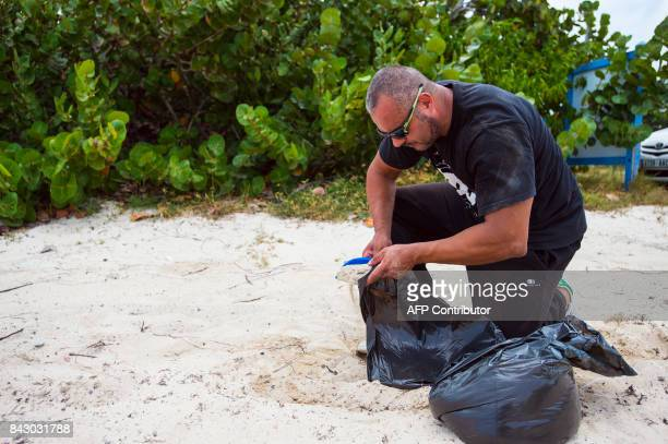 A Man Prepares Sandbags As Part Of Preparations For Arrival Hurricane Irma On September 5