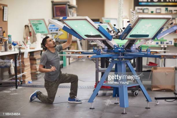 Man prepares screen printer