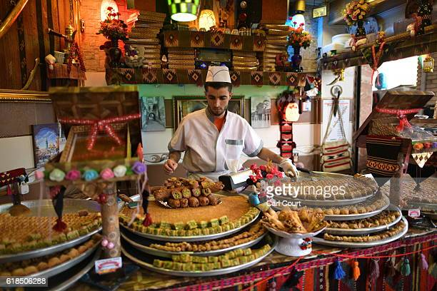 A man prepares sweet pastries in a shop in Erbil bazaar on October 26 2016 in Erbil Iraq As the offensive by Iraqi and Kurdish forces to drive...