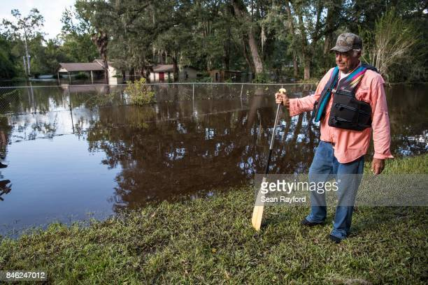 A man prepares to leave flood waters in his neighborhood caused by Hurricane Irma September 12 2017 in Middleburg Florida United States The storm...