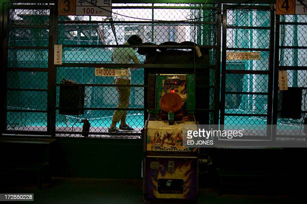 A man prepares to swing his bat inside a baseball cage in Seoul on July 3 2013 One of Asia's most affluent countries South Korea is the region's...