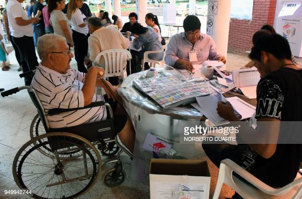 A man prepares to vote at a polling station during general elections in Asuncion on April 22 2018 Opinion polls give Mario Abdo Benitez of the ruling...