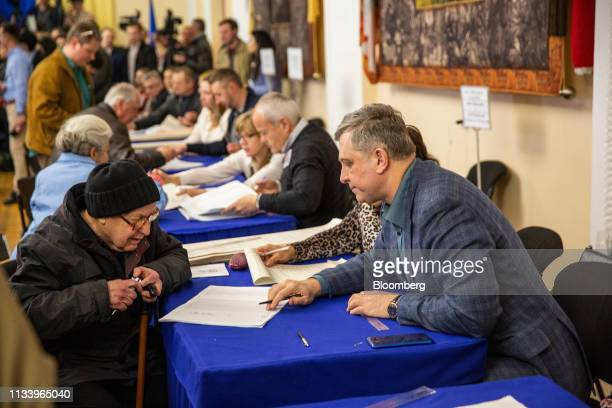 A man prepares to vote at a polling station in Kiev Ukraine on Sunday March 31 2019 Ukrainians will choose between a field of almost 40 candidates in...
