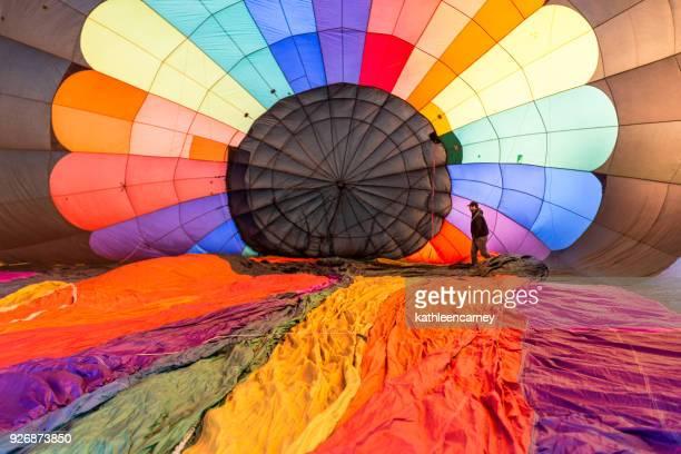 Man preparing a hot air balloon for take off