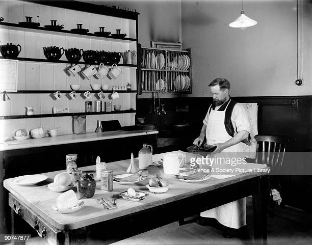 Man preparing a meal in the kitchen of the enginemen's hostel. The Great Eastern Railway provided the hostel for train crews forced by their duties...