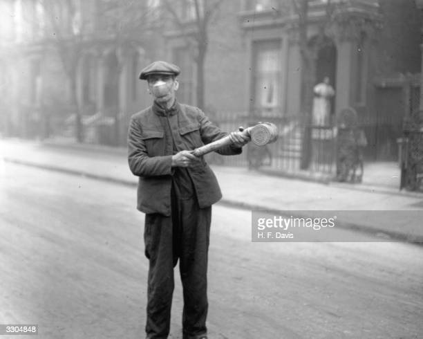 Man preparing 'Anti-flu' spray for buses of the London General Omnibus Co, London, 2nd March 1920.