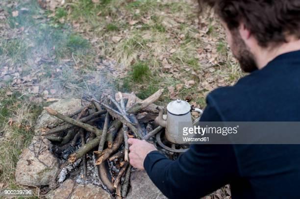 man preparing campfire - überleben stock-fotos und bilder