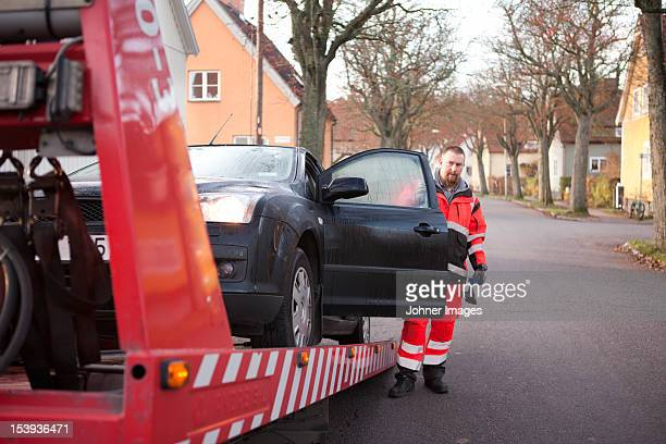 Man preparing car to get towed