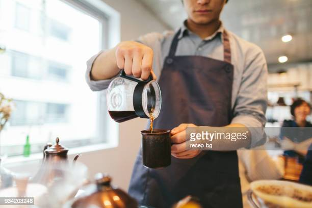 man preparing coffee - caffeine stock pictures, royalty-free photos & images