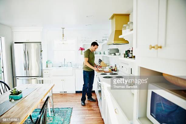 Man preparing dinner in home kitchen