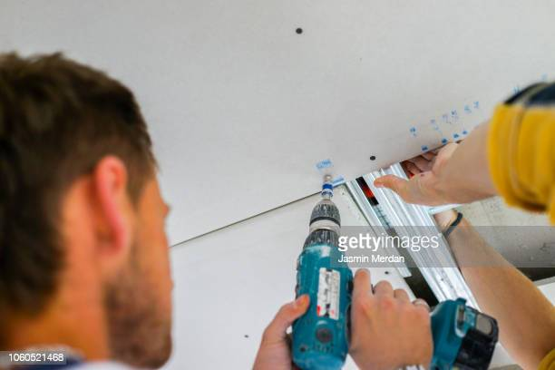 Man preparing drywall