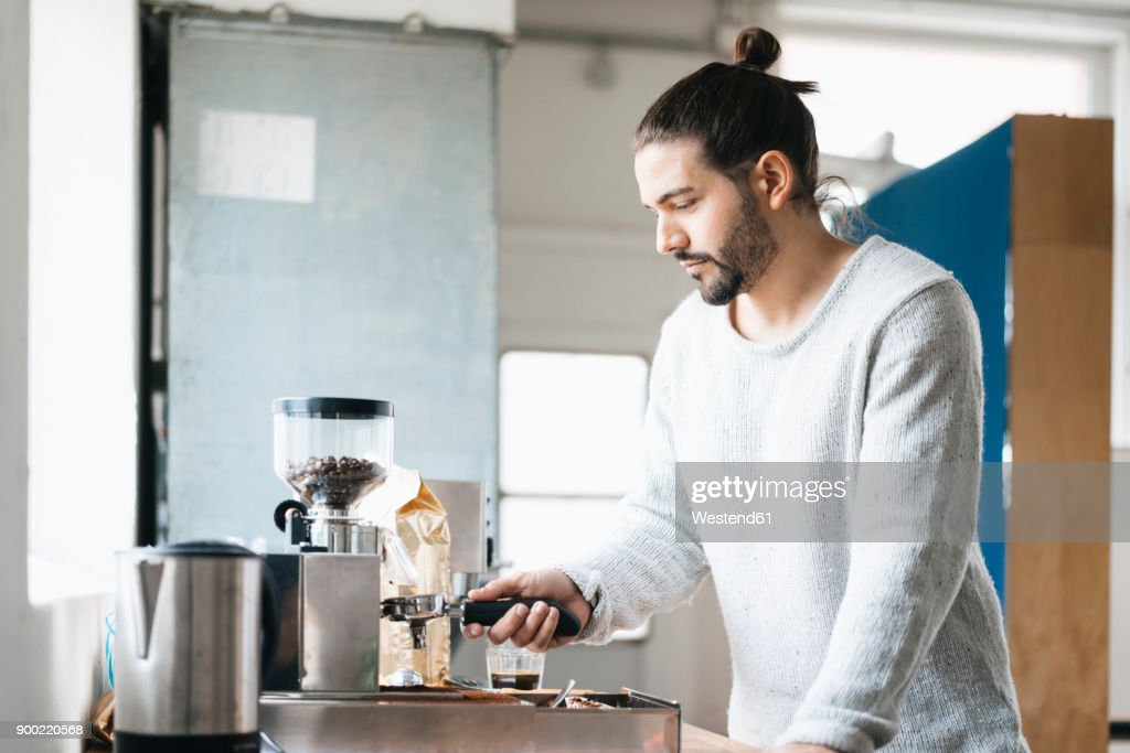 Man preparing espresso with espresso machine : Stock Photo