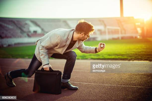 man preparing for final race - time management stock photos and pictures
