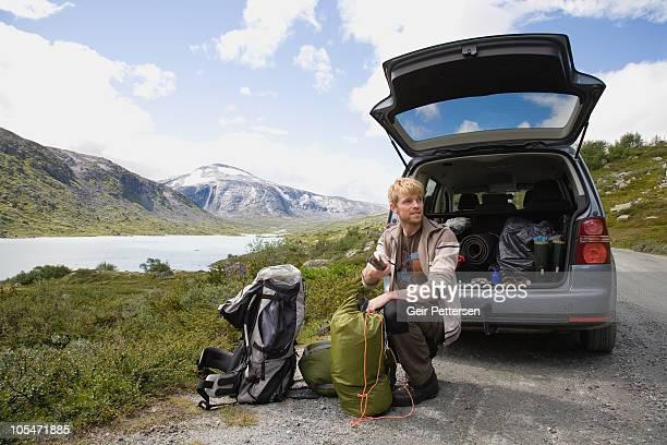 Man preparing for hiking/camping trip