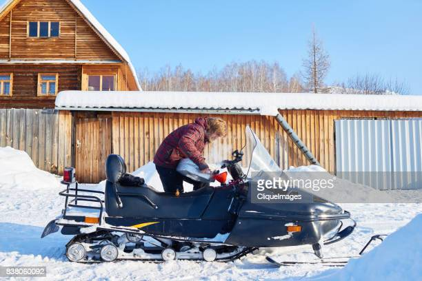 man preparing for snowmobile ride - cliqueimages stock pictures, royalty-free photos & images