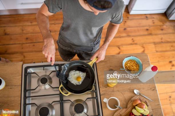 Man preparing healthy breakfast in the kitchen