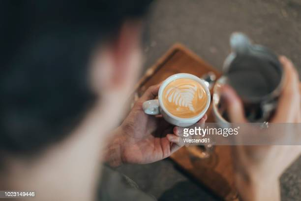 man preparing milk coffee - 調理方法 ストックフォトと画像