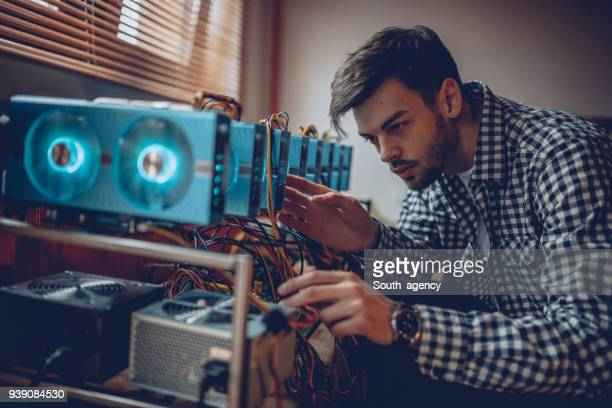 Man preparing mining rig for cryptocurrency mining