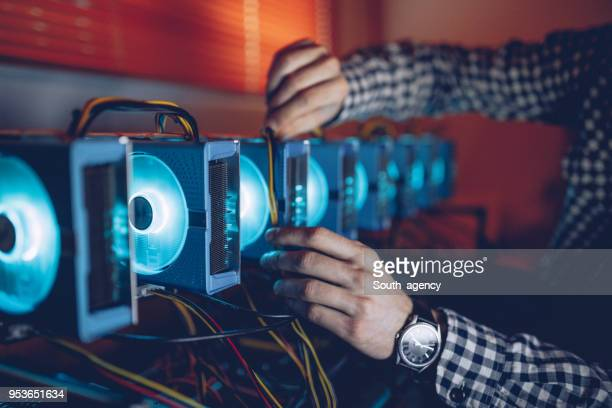 man preparing mining rig - cryptocurrency mining stock pictures, royalty-free photos & images
