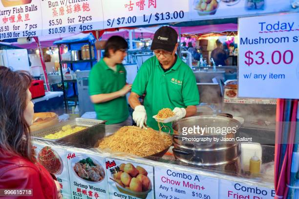 man preparing noodles in the richmond night market near vancouver, canada. - richmond british columbia stock photos and pictures