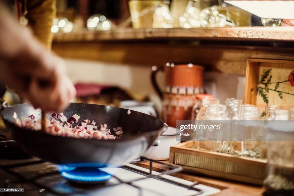 Man preparing pasta on gas stove : Stock Photo