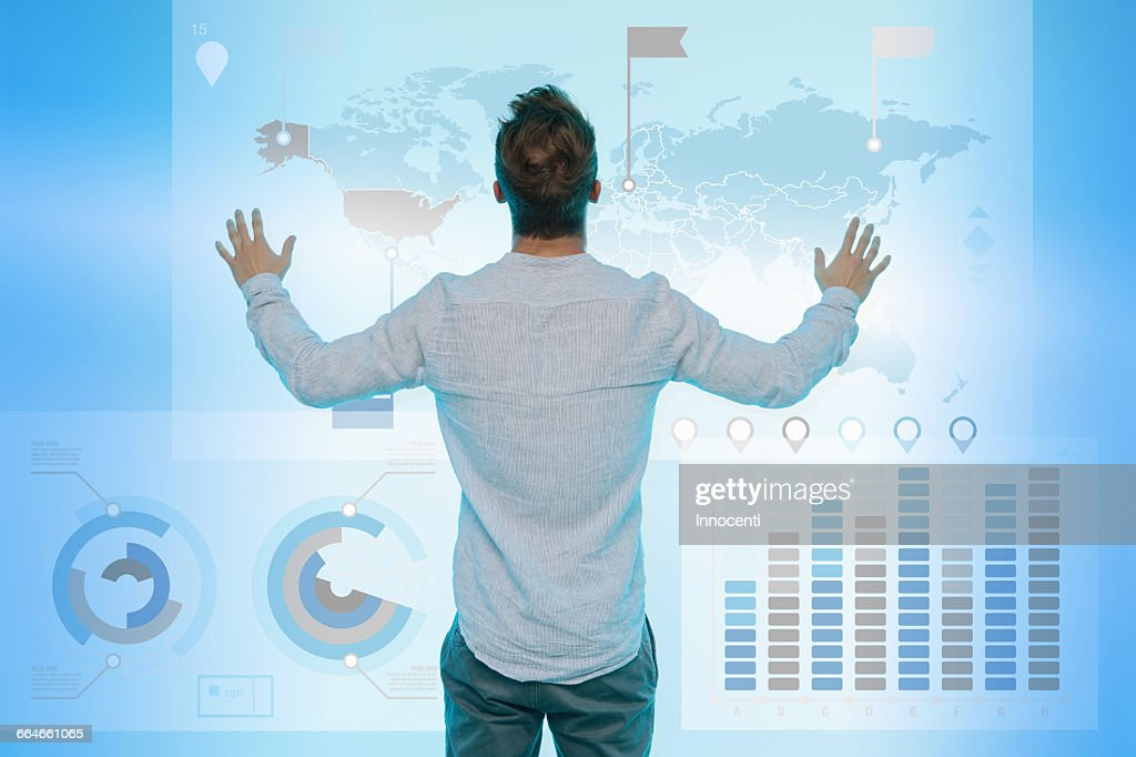 Man preparing presentation on graphical screen, rear view : Stock Photo