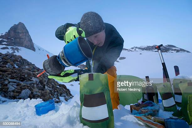 Man preparing ready meals to the bivouac camp, Tyrol, Austria