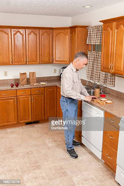 Man Preparing School Lunches