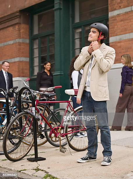Man preparing to commute by bicycle