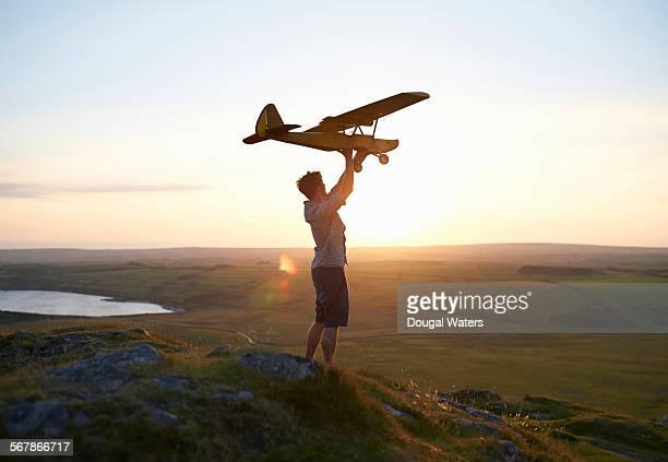 Man preparing to fly large model air plane.