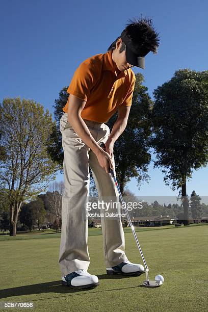 Man Preparing to Putt