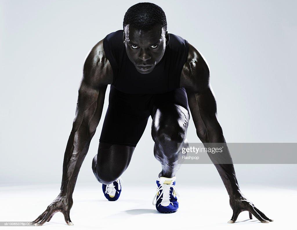 Man preparing to race, portrait, close-up : Foto stock
