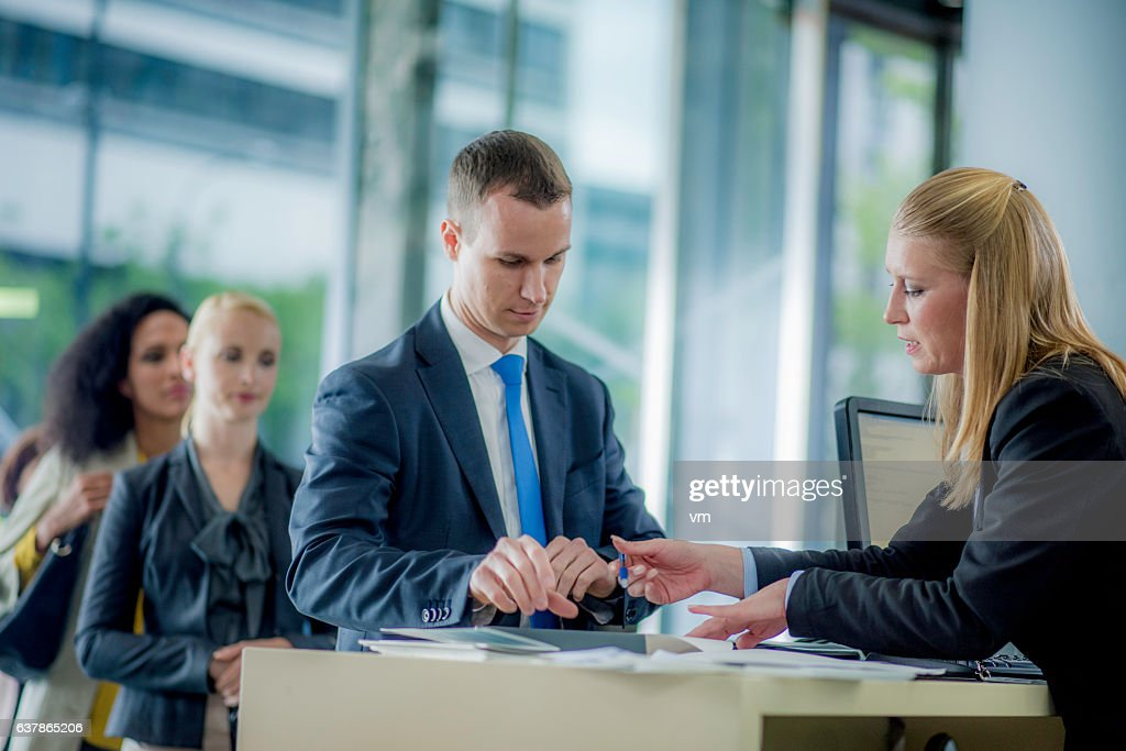 Man preparing to sign a bank contract : Stock Photo