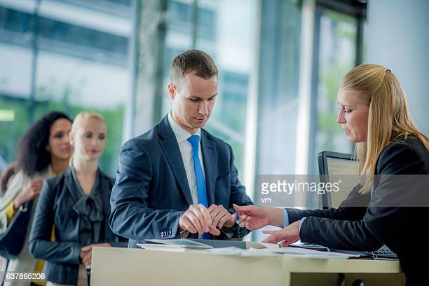 man preparing to sign a bank contract - cashier stock pictures, royalty-free photos & images