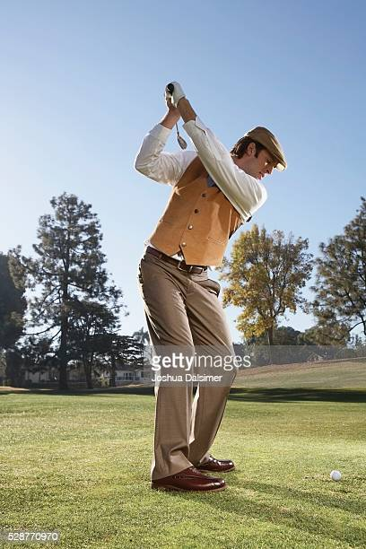 Man Preparing to Swing a Golf Club